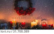 Купить «Falling snow with Christmas candles», видеоролик № 31700389, снято 2 ноября 2018 г. (c) Wavebreak Media / Фотобанк Лори
