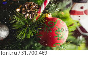 Купить «Falling snow with Christmas tree decorations», видеоролик № 31700469, снято 2 ноября 2018 г. (c) Wavebreak Media / Фотобанк Лори