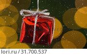 Falling snow and Christmas gift  decoration. Стоковое видео, агентство Wavebreak Media / Фотобанк Лори