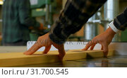 Купить «Carpenter using table saw in workshop 4k», видеоролик № 31700545, снято 9 августа 2018 г. (c) Wavebreak Media / Фотобанк Лори