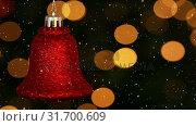 Купить «Video composition with falling snow over blurry video of Christmas tree lights and red bell», видеоролик № 31700609, снято 2 ноября 2018 г. (c) Wavebreak Media / Фотобанк Лори