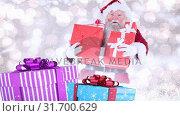 Купить «Santa clause with christmas presents combined with falling snow», видеоролик № 31700629, снято 2 ноября 2018 г. (c) Wavebreak Media / Фотобанк Лори