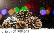 Купить «Falling snow with pine cone Christmas decoration», видеоролик № 31700649, снято 2 ноября 2018 г. (c) Wavebreak Media / Фотобанк Лори