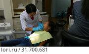 Купить «Female dentist examining a patient 4k», видеоролик № 31700681, снято 5 августа 2018 г. (c) Wavebreak Media / Фотобанк Лори