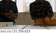 Купить «Carpenter using table saw in workshop 4k», видеоролик № 31700833, снято 9 августа 2018 г. (c) Wavebreak Media / Фотобанк Лори