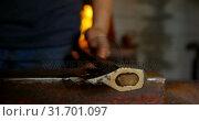 Купить «Metalsmith placing tool on anvil in factory», видеоролик № 31701097, снято 15 сентября 2018 г. (c) Wavebreak Media / Фотобанк Лори