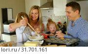 Купить «Parents teaching their kids to prepare the dough in the kitchen 4k», видеоролик № 31701161, снято 30 августа 2018 г. (c) Wavebreak Media / Фотобанк Лори