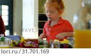 Купить «Cute little boy eating cake at dining table 4k», видеоролик № 31701169, снято 30 августа 2018 г. (c) Wavebreak Media / Фотобанк Лори