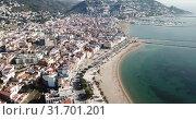 Купить «View from drone of famous tourist town of Roses on Catalan coast of Gulf of Roses, Costa Brava, Spain», видеоролик № 31701201, снято 10 февраля 2019 г. (c) Яков Филимонов / Фотобанк Лори