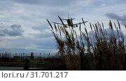 Купить «Vueling Airlines plane arriving at El Prat Airport on schedule. Barcelona, Catalonia», видеоролик № 31701217, снято 2 февраля 2019 г. (c) Яков Филимонов / Фотобанк Лори