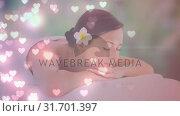 Купить «Woman relaxing in wellness center », видеоролик № 31701397, снято 6 ноября 2018 г. (c) Wavebreak Media / Фотобанк Лори