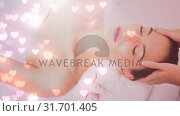Купить «beautiful women having massage at spa for valentine day», видеоролик № 31701405, снято 6 ноября 2018 г. (c) Wavebreak Media / Фотобанк Лори
