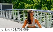 Купить «Beautiful young dancer practicing dance on the bridge in the city 4k», видеоролик № 31702089, снято 26 сентября 2018 г. (c) Wavebreak Media / Фотобанк Лори