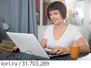 Woman surfing in Internet using laptop. Стоковое фото, фотограф Яков Филимонов / Фотобанк Лори
