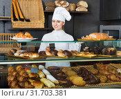 Купить «Glad female cooks demonstrating and selling to the customer pastry», фото № 31703381, снято 23 июля 2019 г. (c) Яков Филимонов / Фотобанк Лори