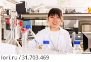 Купить «Female Chinese chemist working in laboratory», фото № 31703469, снято 28 мая 2019 г. (c) Яков Филимонов / Фотобанк Лори