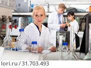 Купить «Student working in college laboratory», фото № 31703493, снято 28 мая 2019 г. (c) Яков Филимонов / Фотобанк Лори