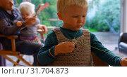 Купить «Boy holding thread and sewing needle at home 4k», видеоролик № 31704873, снято 28 мая 2018 г. (c) Wavebreak Media / Фотобанк Лори