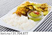 Купить «Leaves of cabbage in batter with rice and green sauce on a plate», фото № 31704877, снято 28 мая 2020 г. (c) Яков Филимонов / Фотобанк Лори