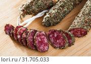 Купить «Fuet sausage coated with herbs», фото № 31705033, снято 23 июля 2019 г. (c) Яков Филимонов / Фотобанк Лори