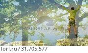 Купить «Man jumping on rocks on top of a mountatin 4k», видеоролик № 31705577, снято 17 апреля 2019 г. (c) Wavebreak Media / Фотобанк Лори
