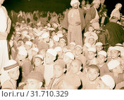 Halhul village at kilometer 30 on Hebron road Night gathering in Halhul village, school boys in Halhul waiting for a cinema show. 1940, West Bank, ?al?ul, Middle East (2018 год). Редакционное фото, фотограф © Liszt Collection / age Fotostock / Фотобанк Лори