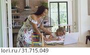 Купить «Mother helping her daughter with homework in a comfortable home 4k», видеоролик № 31715049, снято 12 марта 2019 г. (c) Wavebreak Media / Фотобанк Лори