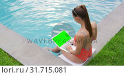 Купить «Woman using laptop near swimming pool in the backyard 4k», видеоролик № 31715081, снято 12 марта 2019 г. (c) Wavebreak Media / Фотобанк Лори