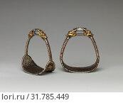 Купить «Two Stirrups, 16th–17th century, Mongolian or Tibetan, Iron, gold, silver, H. 6 1/2 in. (16.5 cm), W. 5 11/16 in. (14.4 cm), Wt. 22 oz. (617 g), Equestrian...», фото № 31785449, снято 7 мая 2017 г. (c) age Fotostock / Фотобанк Лори