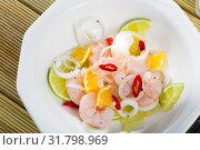 Купить «Ceviche with shrimps, lime, orange», фото № 31798969, снято 21 ноября 2019 г. (c) Яков Филимонов / Фотобанк Лори