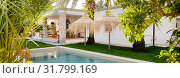 Купить «Panoramic image inner garden with private swimming pool straw parasol beautiful luxury wealthy residential summer villa, sunny day, no people. Spain», фото № 31799169, снято 2 июля 2019 г. (c) Alexander Tihonovs / Фотобанк Лори