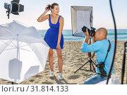 Купить «Woman posing for photographer on seaside», фото № 31814133, снято 5 октября 2018 г. (c) Яков Филимонов / Фотобанк Лори