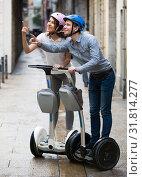 Купить «couple traveling by segways», фото № 31814277, снято 24 августа 2019 г. (c) Яков Филимонов / Фотобанк Лори