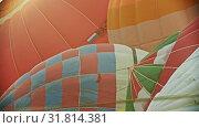 Купить «Preparing air balloons for the flight», видеоролик № 31814381, снято 11 июля 2020 г. (c) Константин Шишкин / Фотобанк Лори