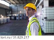 Купить «Male staff in hardhat and reflective jacket standing in warehouse», фото № 31829217, снято 23 марта 2019 г. (c) Wavebreak Media / Фотобанк Лори