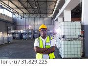 Купить «Male staff in hardhat and reflective jacket standing with arms crossed in warehouse», фото № 31829225, снято 23 марта 2019 г. (c) Wavebreak Media / Фотобанк Лори