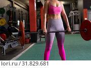 Купить «Woman exercising», фото № 31829681, снято 24 марта 2019 г. (c) Wavebreak Media / Фотобанк Лори