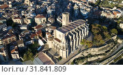 Купить «Aerial view of Manresa town with Basilica de Santa Maria, Catalonia, Spain», видеоролик № 31841809, снято 24 декабря 2018 г. (c) Яков Филимонов / Фотобанк Лори