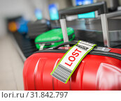 Купить «Suitcase with lost sticker on an airport baggage conveyor or baggage claim transporter.», фото № 31842797, снято 29 января 2020 г. (c) Maksym Yemelyanov / Фотобанк Лори