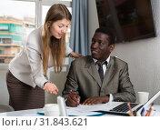 Купить «Friendly coworkers working together», фото № 31843621, снято 10 июля 2020 г. (c) Яков Филимонов / Фотобанк Лори
