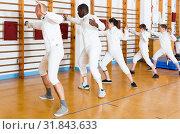 Купить «Ordinary group of athletes at fencing workout», фото № 31843633, снято 30 мая 2018 г. (c) Яков Филимонов / Фотобанк Лори