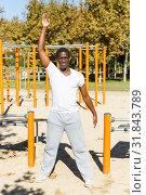 Купить «Smiling african american man standing near pull-up bar at sports ground», фото № 31843789, снято 3 ноября 2018 г. (c) Яков Филимонов / Фотобанк Лори