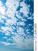 Купить «Небесный закатный пейзаж. Синее небо. Blue dramatic sky background - white dramatic colorful clouds lit by sunlight. Vast sky landscape panoramic scene», фото № 31844689, снято 24 мая 2019 г. (c) Зезелина Марина / Фотобанк Лори