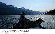 Купить «Fisherman fishing with his dog in the river 4k», видеоролик № 31845661, снято 30 июля 2018 г. (c) Wavebreak Media / Фотобанк Лори