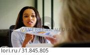 Купить «Business colleagues interacting with each other at desk 4k», видеоролик № 31845805, снято 14 сентября 2018 г. (c) Wavebreak Media / Фотобанк Лори