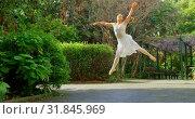 Купить «Young ballerina dancing in the park 4k», видеоролик № 31845969, снято 26 сентября 2018 г. (c) Wavebreak Media / Фотобанк Лори