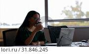 Купить «Female executive using laptop at desk in office 4k», видеоролик № 31846245, снято 25 августа 2018 г. (c) Wavebreak Media / Фотобанк Лори