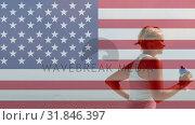 Купить «American flag video», видеоролик № 31846397, снято 20 ноября 2018 г. (c) Wavebreak Media / Фотобанк Лори