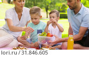 Купить «happy family eating fruits on picnic at park», видеоролик № 31846605, снято 21 июля 2019 г. (c) Syda Productions / Фотобанк Лори