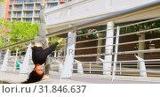 Купить «Female young dancer practicing dance on the bridge 4k», видеоролик № 31846637, снято 26 сентября 2018 г. (c) Wavebreak Media / Фотобанк Лори